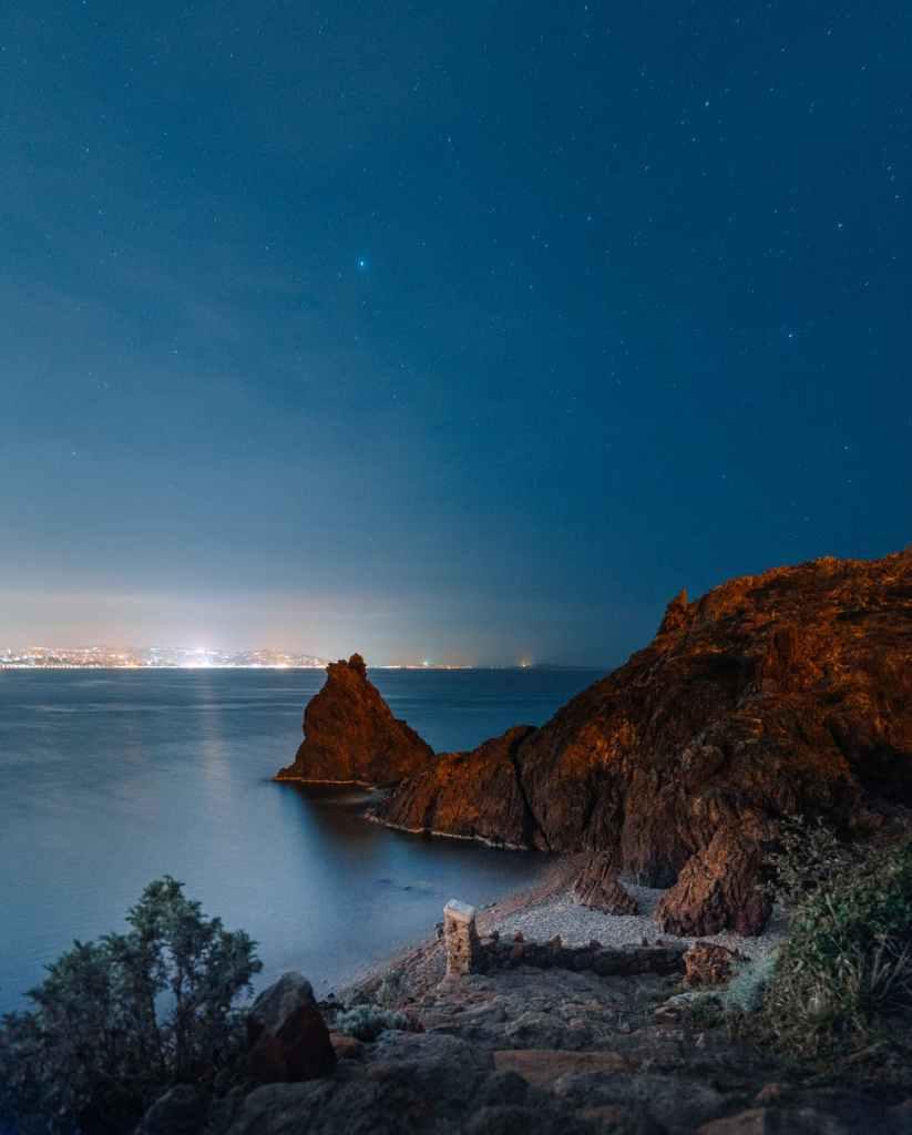 rocky ocean coast against starry sky