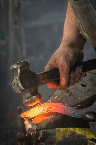 man forging metal