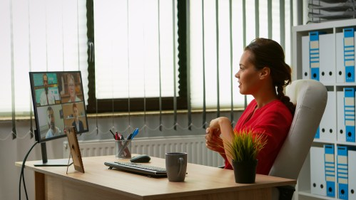 Freelancer speaking on video call in modern office. Administrator working with business remotely team discussing chatting having virtual online conference, meeting, webinar using internet technology
