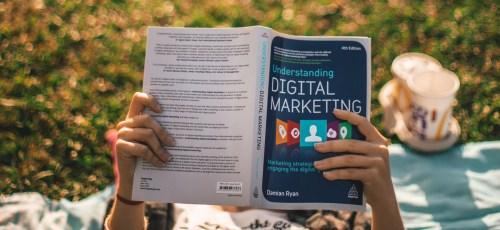 student reading digital marketing book