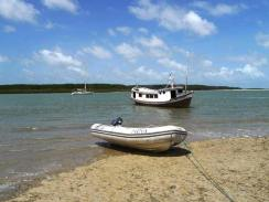 Mina2 anchored off the village