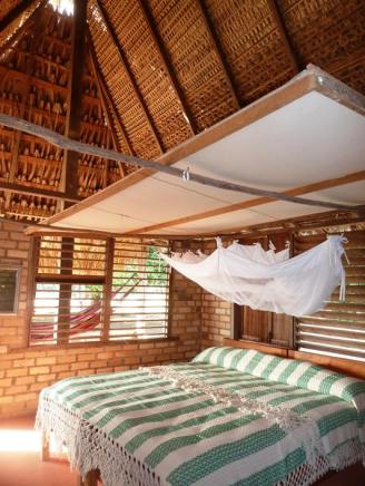 The canopy above the bed is to prevent the bats poo from falling on you at night
