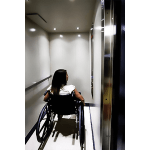 Passenger in wheelchair inside the LU/LA elevator