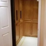 Symmetry Home Elevator Red Oak Clear Coat with Vintage Bronze hardware