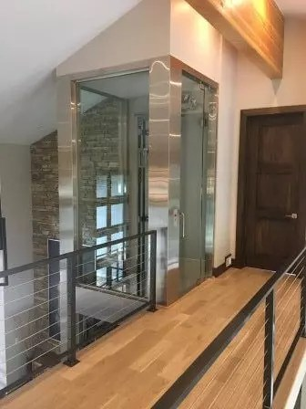 Symmetry Home Elevator Stainless Steel and Glass Hoistway