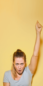 Woman with fist triumphantly in the air
