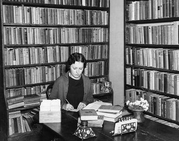 Librarian_working_at_the_Pointe_Coupee_Parish_Parish_library_in_New_Roads_Louisiana_in_1936