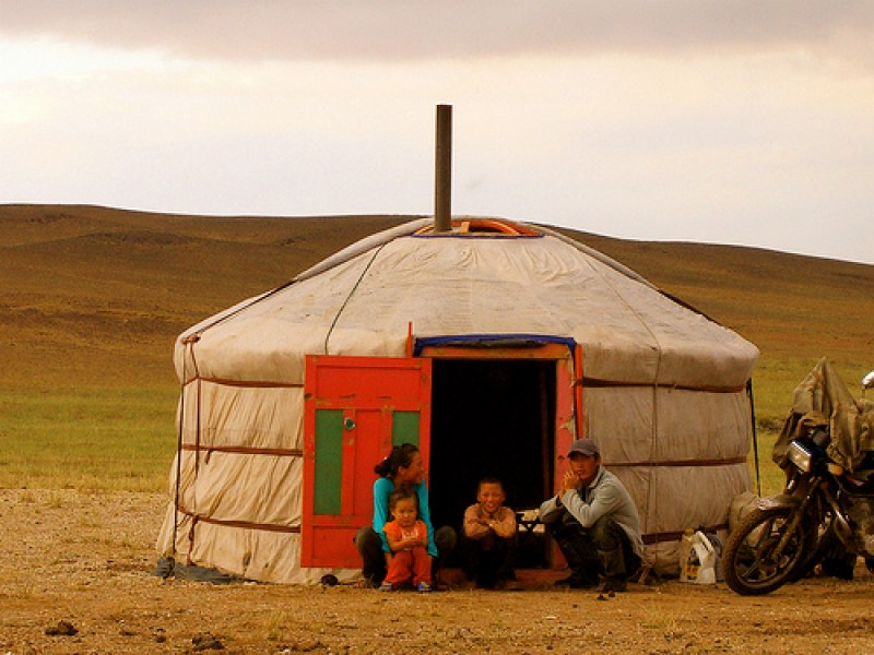 Mongolian nomads in front of their ger. © The Wandering Angel with CCLicense