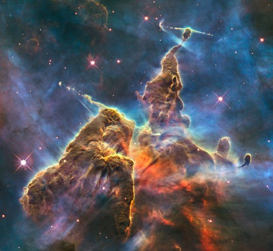 """Mystic Mountain, in the constellation Carina. The formation is three light years tall, full of baby stars letting off jets of gas.  """"Hubble's Wide Field Camera 3 observed the pillar on 1-2 February 2010. The colours in this composite image correspond to the glow of oxygen (blue), hydrogen and nitrogen (green), and sulphur (red)."""" --ESA/Hubble Credit: NASA, ESA, M. Livio and the Hubble 20th Anniversary Team (STScI)"""