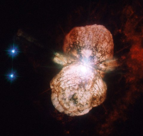 """Binary star system Eta Carinae within the Homunculus Nebula, which lies within  in the Carina Nebula and Constellation, about 7,500 light years away from Earth. This shows a false supernova which stopped short of killing the star. """"This image, taken with the Advanced Camera for Surveys High Resolution Channel is the most detailed yet, and shows how the material from the star was not thrown out in a uniform manner, but forms a huge dumbbell shape."""" --ESA/Hubble Credit: ESA/Hubble & NASA"""