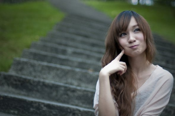 9382-a-beautiful-chinese-girl-sitting-on-steps-making-a-silly-face-pv.jpg