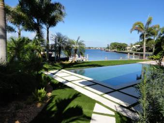Synthetic Turf International SoftLawn Lawn and Landscape Artificial Grass with Pool