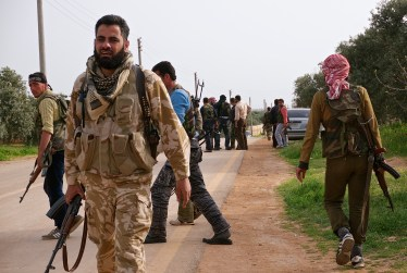 Cmdr. Issa coordinates with varying Free Army and Mujahedin brigades to plan the siege of Fou'a, Idlib Province.