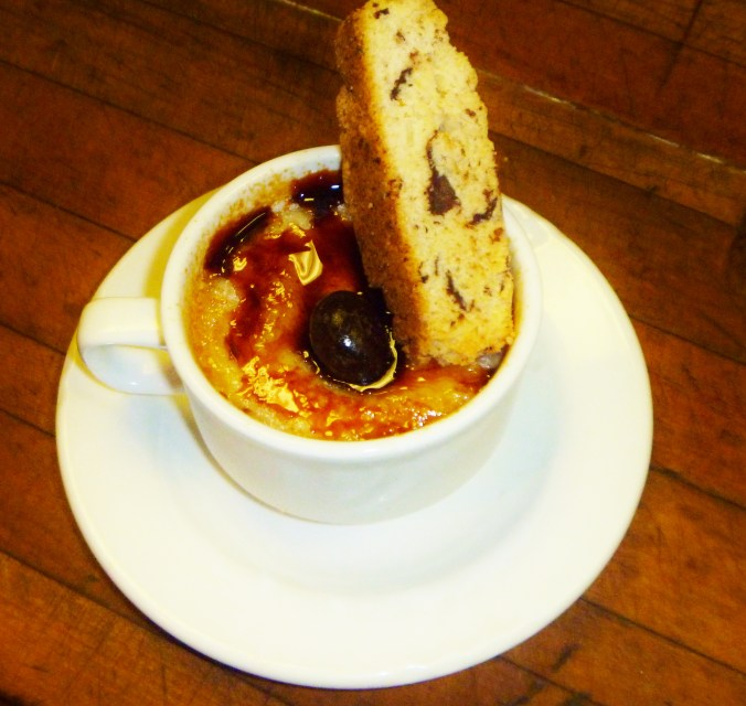 Espresso flavored custard topped with caramelized pastry cream.  Served with biscotti