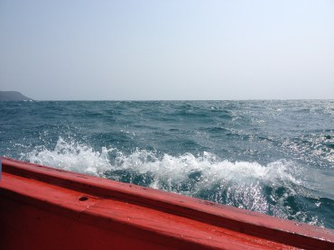 Waves were splashing on us and the boat. I was sitting at that side