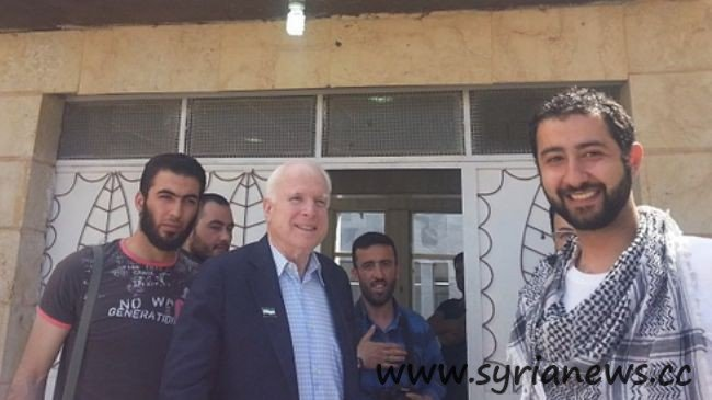 Hawkish US Senator John McCain (C) poses with infamous kidnapper in Syria, Mohamed Nour (seen with his hand on his chest and holding a camera)