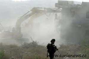 An isreali soldier and the bulldozer