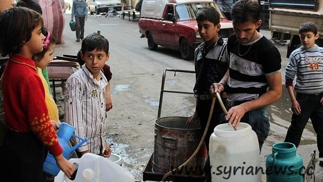 Syrians fill up plastic containers with water in as the northern city suffers from a power and water shortage. Syrian rebels retook a strategic base in the northern Aleppo province, as shelling killed at least 11 people in nearby Aleppo city, the Syrian Observatory for Human Rights said. AFP PHOTO/KARAM AL-MASRI