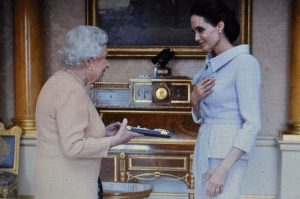 """Jolie being Dam[n]ed by Queen parasite """"for services to United Kingdom foreign policy."""""""