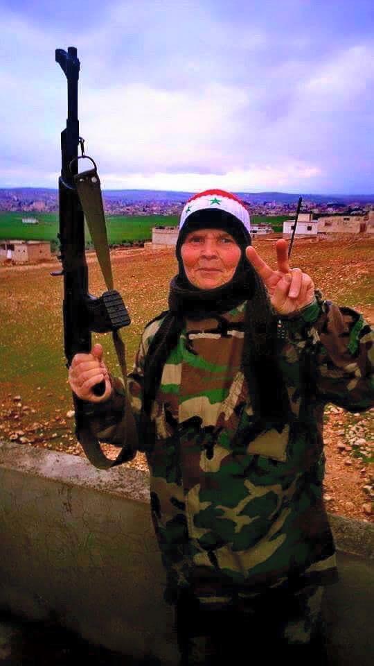 Syrian elderly women defending their towns