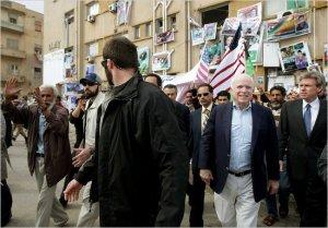 Illegal alien McCain, in Libya, organizing with al Qaeda.