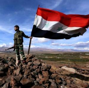 Syrian soldier with Syrian flag
