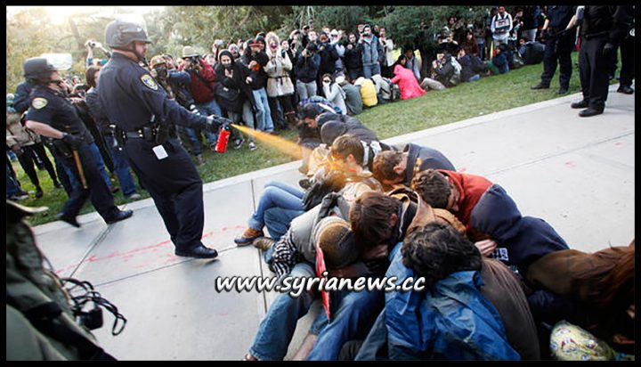 US Police Force Pepper Spray Sitting Students - Imagine if they weren't just sitting in their university campus and instead carrying guns!