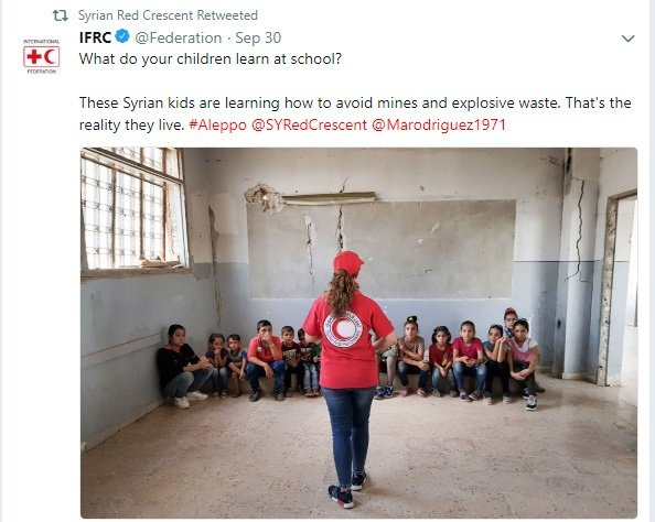 SARC volunteer teaching kids how to avoid mines