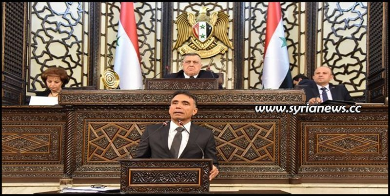 Syrian minister of education in front of Parliament