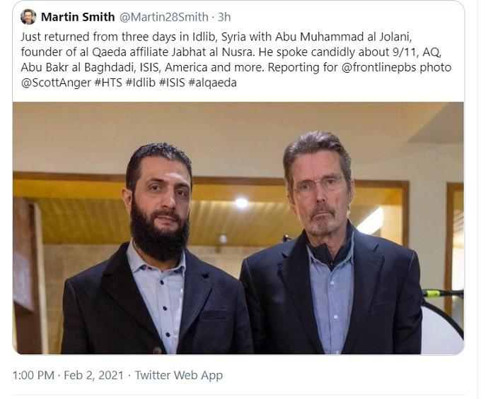 al Qaeda's Jolani dressed in matching suits.