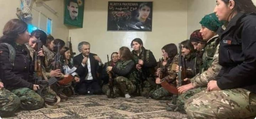 Great white hope illegally in Syria, with young, armed, female SDF terrorists.