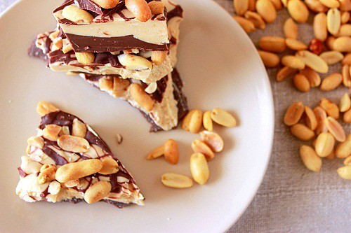 Peanut Butter Chocolate Bark. A layer of chocolate and a layer of peanut butter topped with salted peanuts. #chocolate #bark #peanutbutter #peanuts #southernfood