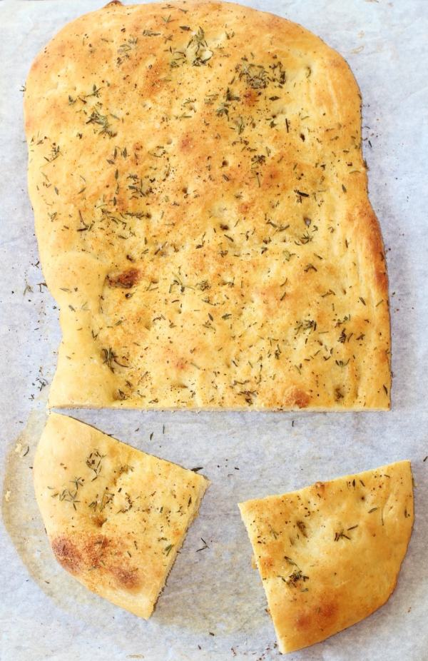 Garlic and Herb Focaccia Bread. Make quick work of this bread by using a frozen dough. #garlic #herb #focaccia #bread