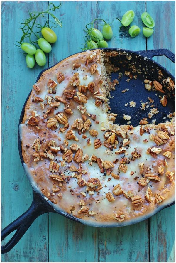 Green Tomato Skillet Cake. Spice cake with green tomatoes, pecans and raisins topped with a warm butter icing and toasted pecans.