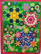 Mange av årets quilter hadde sterke farger - denne falt jeg for - sikkert fordi det er noe jeg ikke har tålmodighet til selv. Quilten er laget av Tove Marie Bach og quiltet av BeoBeo