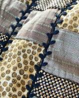 Beltet består av mange små stoffbiter av silke og bomull. Sømmen er kråkespark sydd på symaskinen med tykk tråd i undertråden. Denne type søm ble faktisk brukt for å dekorere og styrke sømmene på klærne i vikingetiden