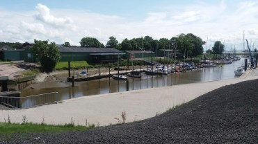 The harbor at the Elbe river side next to the Brunsbuttel lock in low tide.