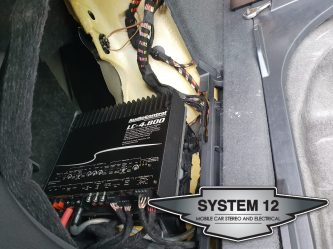 Audio Control LC4.800 hidden in the rear left panel
