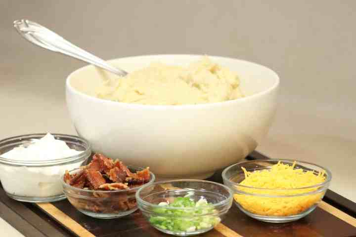 Garlic and thyme mashed potatoes, with loaded toppings (cheese, bacon, sour cream, green onions)