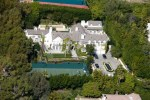 This monster home was purchased by Seacrest off of Ellen Degeneres and Portia de Rossi for an amazing 49 million dollars. The house is located in Beverly Hills and has 2 other smaller homes on the properly for guest to stay in. It was originally purchased for 29 million but Ellen and Portia added 9,500 square feet to the home which increased the value dramatically