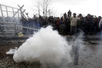 Stranded refugees and migrants flee tear gas fire by the Macedonian police, after trying to bring down part of the border fence during a protest at the Greek-Macedonian border, near the Greek village of Idomeni, February 29, 2016. REUTERS/Alexandros Avramidis
