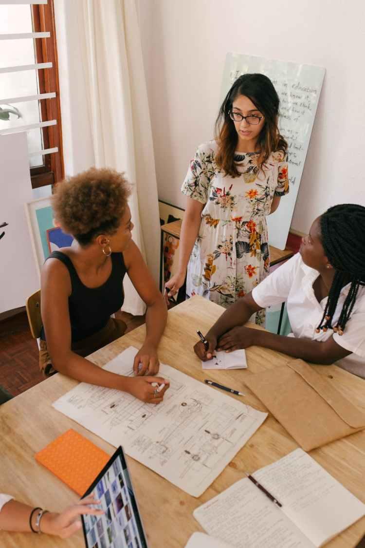 photo of women having a meeting