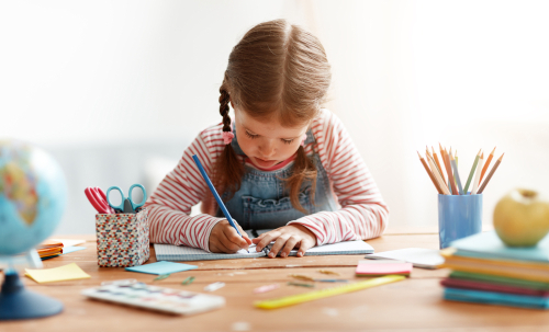A,Funny,Child,Girl,Doing,Homework,Writing,And,Reading,At