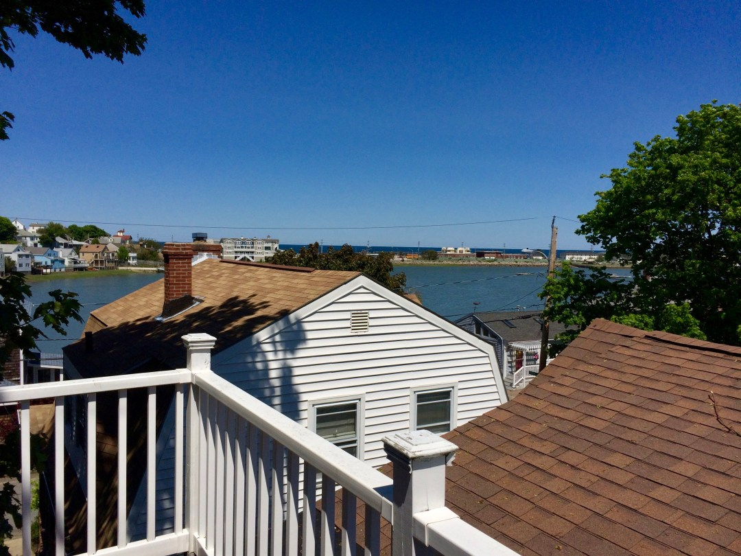 view of bay and ocean from roof deck