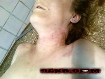 dead naked woman beheaded