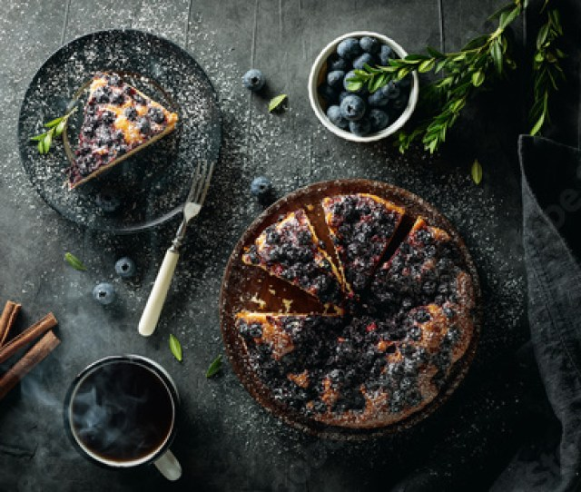 Flat Lay With Sliced Homemade Blueberry Pie On Rough Dark Rusty Background