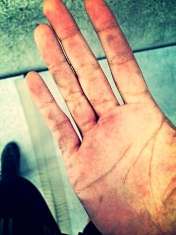 Hands of a rock climber.