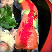 Salmon, avocado and fish egg roll.