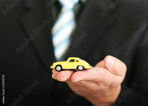 Sales agent offering a car stock image