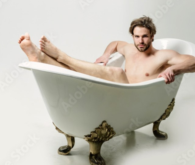 Handsome Naked Man Sitting In Bath Barefoot